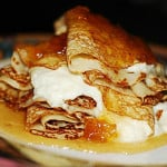 Crepes with agave-ricotta cheese filling, topped with pears roasted in honey