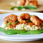 Spicy curry shrimp pasta: curried tomato sauce, snap peas and orzo