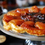 Apple tarte tatin, or simply caramel apple tart, with strawberries